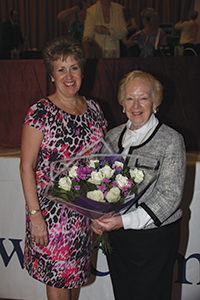 Anne Lingard receiving a bouquet from Vice-Chairman of  the Dancesport Faculties' Board, Yvonne Taylor-Hill, as a thank you for acting as a Congress organiser