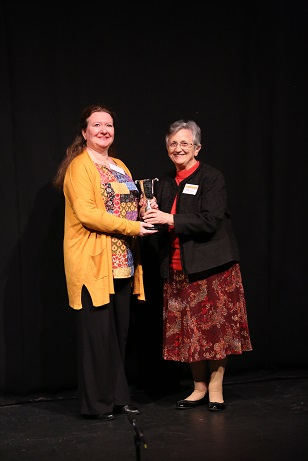2018 Isobel Haxell Cup being presented to Annette Clark by Faculty Chair Jacky Ferguson