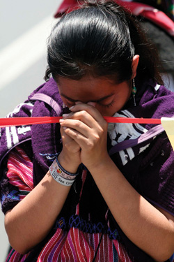 Mexican woman from Chiapas State praying at Easter