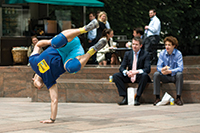 Tim Casson choreographing with members of the public in Canary Wharf, photo by Jack Davies