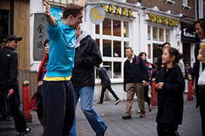 Tim Casson choreographing with members of the public in Brixton, photo by Luc Sung Yu Lun